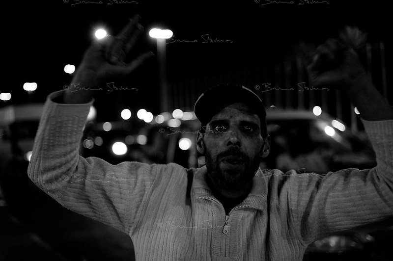Tripoli, Libya, March 12, 2011.An eerie calm reigns in the medina, the ancient city center. Signs of support for the Khaddafi regime are everywhere to be seen, and 'sponaneous' expressions of support appear as soon as a foregn journalist appears. However, evidence suggest that a number of young men are 'bussed in' Green Square to express the fervor of the libyan people for its leader. Many of them appear to be under influence of either alcool or drugs and behave quite aggressively.