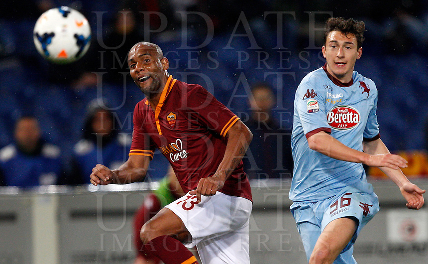 Calcio, Serie A: Roma vs Torino. Roma, stadio Olimpico, 25 marzo 2014.<br /> AS Roma defender Maicon, of Brazil, and Torino defender Matteo Darmian, right, eye the ball during the Italian Serie A football match between AS Roma and Torino at Rome's Olympic stadium, 25 March 2014.<br /> UPDATE IMAGES PRESS/Riccardo De Luca