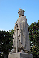 Statue of Saint Louis or King Louis IX of France, 1951, by Albert-Marius Patrisse, 1892-1964, Poissy, Yvelines, France. Saint Louis was born in Poissy in 1214 and baptised in the Collegiale Notre-Dame de Poissy (next to this statue) in the same year. Picture by Manuel Cohen