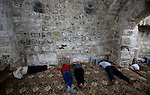 Palestinian muslims rest at a mosque during the holy month of Ramadan in West Bank City of Nablus, on June 30, 2014. Muslims around the world refrain from eating, drinking and sexual intercourse from dawn till dusk during Ramadan, the holiest month in the Islamic calendar. Photo by Nedal Eshtayah