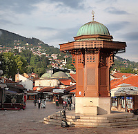 The Sebilj, a public fountain in Ottoman style made from wood on a stone base, built 1891, in Bascarsija Square, Sarajevo, Bosnia and Herzegovina. The square is also called Pigeon Square as people sit in the cafes drinking coffee and feeding the many pigeons which congregate here. The city was founded by the Ottomans in 1461. Picture by Manuel Cohen