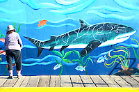 Janet Wallace paints a mural at the Santa Monica Pier on Friday, March 2, 2012.