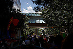 Spectators watch a protest march from a walkway two days before the 2012 Democratic National Convention in Charlotte, N.C. on Sept. 2, 2012.