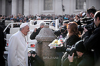 Pope Francis holds a birthday cake shaped as a Mexican sombrero which was handed to him by Mexican Journalist Valentina Alazraki on the occasion of his arrival for the weekly general audience at the Vatican, Wednesday, Dec. 16, 2015. Pope Francis enters his 80th year on Thursday.
