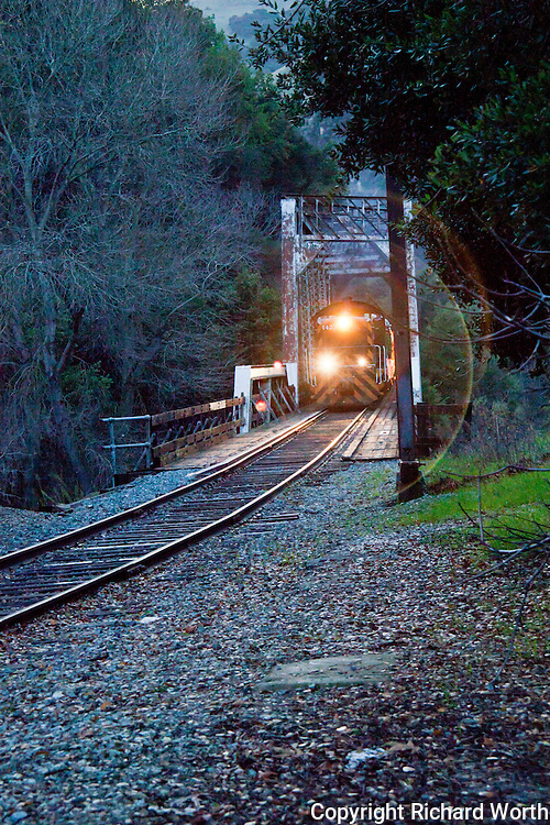 The Train of LIghts crosses a bridge in Niles Canyon and passes by on its way to Sunol, California.