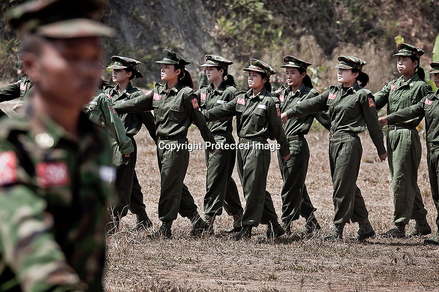KIA female officers perform a military training at the School of Officers situated in a secret location in the high mountains some kilometers away from the Laiza city, the headquarters of the Kachin Independence rebel Army. Since the begining of the Kachin uprising for its sovereignty women always fought by side the rebel soldiers, but officially, the female KIA was founded in 2007, since then, up to 1500 women have joint to the rebel army. The KIA is enhancing its troops number since the ceasefire was broken out by the Burmese army last June 2011.