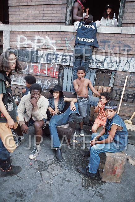 """New York, NY July 1972 - New York street gang """"Savage Skulls"""". The trademark of the primarily Puerto Rican gang was a sleeveless denim jacket with a skull and crossbones design on the back. Based in the Hunts Point area of the  South Bronx, the gang declared war on the drug dealers that operated in the area. Running battles were frequent with rival gangs """"Seven Immortals"""" and """"Savage Nomads""""."""