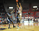 "Ole Miss' Marshall Henderson (22) shoots vs. East Tennessee State's Lester Wilson (15) at the C.M. ""Tad"" Smith Coliseum in Oxford, Miss. on Saturday, December 14, 2012. Mississippi won 77-55 to improve to 7-1. (AP Photo/Oxford Eagle, Bruce Newman).."