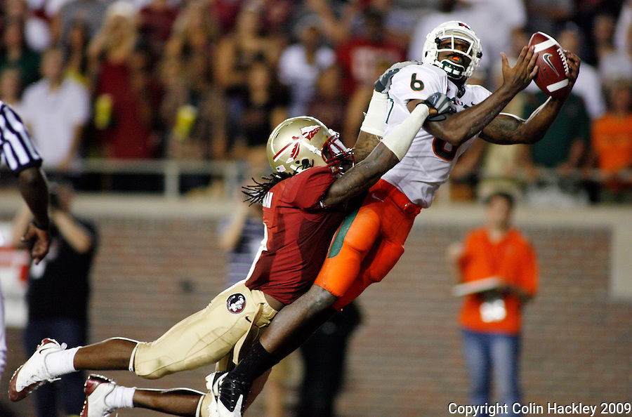 TALLAHASSEE, FL 9/7/09-FSU-MIAMIFB09 CH04-Florida State's Richard Goodman can't keep Miami's Randy Phillips   from intercepting a pass in the endzone at the end of first half action Monday at Doak Campbell Stadium in Tallahassee...COLIN HACKLEY PHOTO