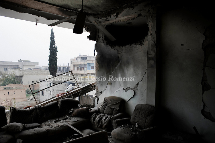 SYRIA - Al Qsair. A destroyed house by a Syrian Army tank shell in Al Qsair, on January 25, 2012. Al Qsair is a small town of 40000 inhabitants, located 25Km south-west of Homs. The town is besieged since the beginning of November and so far it counts 65 dead. ALESSIO ROMENZI
