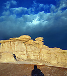 A man casts his shadow across a spectacular landscape