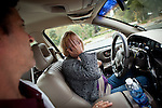 Veterans Affairs driving rehab specialist Marc Samuels, left, helps retired Army Civil Affairs officer Sue Max calm down during a driving simulation in Palo Alto, California on December 15, 2011 to conquer some of the driving fears she gained while serving in Iraq.