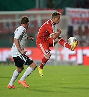 FUSSBALL       DFB POKAL 1. RUNDE        SAISON 2013/2014 BSV Schwarz-Weiss Rehden  - FC Bayern Muenchen  05.08.2013 Viktor Pekrul (li, Rehden) gegen Xherdan Shaqiri (re, FC Bayern Muenchen)