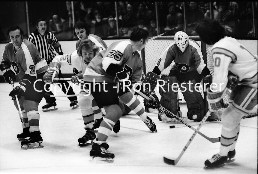 Philadelphia Flyers vs California Golden Seals 1975.<br />Flyers Ed Van Impe, Terry Murray, golie Bernie Parent,..Seals #22 Joey Johnston.<br />(photo/Ron Riesterer)