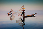 On Myanmar's Inle Lake people practice a very unique style of fishing, gently lowering thimble-shaped nets in a very shallow lake over fish hiding in the water grasses; they then rap their oar against the net, disturbing the fish and causing them to swim into the net.