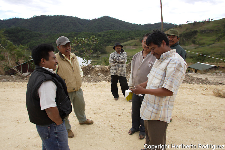Timoteo Alejandro, right, appears in this photo file talking with neighbors in his village of Yosoyuxi, Oaxaca, November 18, 2005. Timoteo Alejandro was shot to death today May 20, 2010. Timoteo was one of the founders of the Autonomous municipality of San Juan Copala, town sieged by paramilitaries since last November who have assassinated almost twenty people.  Photo by Heriberto Rodriguez