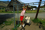 Jennifer Meanus, 5, plays on the monkey bars with little else to do as a member of the Celilo Indian tribe on their reservation in Celilo, Oregon.