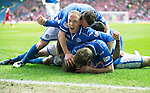 St Johnstone v Aberdeen...13.04.14    William Hill Scottish Cup Semi-Final, Ibrox<br /> Steven Anderson celebrates as his team mates pile on Stevie May after he scored his first goal<br /> Picture by Graeme Hart.<br /> Copyright Perthshire Picture Agency<br /> Tel: 01738 623350  Mobile: 07990 594431