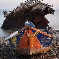 Small fishing boat and shipwreck, Punto San Jacinto, Baja California, Mexico