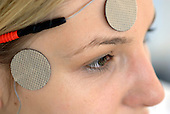 Woman with TENS electrodes on her forehead