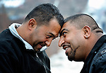 Two Roma men meet with a traditional greeting on the street in the Zemun Polje neighborhood of Belgrade, Serbia.