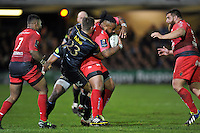 Mathieu Bastareaud of Toulon is tackled by Ollie Devoto of Bath Rugby. European Rugby Champions Cup match, between Bath Rugby and RC Toulon on January 23, 2016 at the Recreation Ground in Bath, England. Photo by: Patrick Khachfe / Onside Images