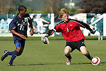 9 November 2005: Virginia Tech goalkeeper Chase Harrison (right) loses the ball to Duke's Zach Pope (left) in the midfield.  Pope played the ball into the open net with 1 second left in the game to give Duke its final 2-0 margin of victory. Duke University defeated Virginia Tech 2-0 at SAS Stadium in Cary, North Carolina in a quarterfinal of the 2005 ACC Men's Soccer Championship.