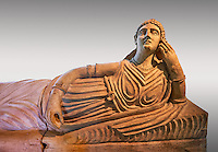 Etruscan Terracotta sarcophagus lid with a female figure reclining, first half of 2nd century BC, inv 15428, The Vatican Museums Rome, Grey Background. For use in non editorial advertising apply to the Vatican Museums for a license.