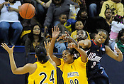 Uconn Connecticut Huskies Tahirah Williams (2) knocks the ball away from Marquette University's Lauren Thomas-Johnson (24) and Jasmine Collins (00) during the second half of the game at the McGuire Center on Saturday, Feb. 7, 2009.