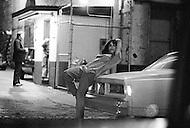 Manhattan, New York City, NY - May, 1980. To quote Travis Bickle from &lsquo;Taxi Driver&rsquo;, &lsquo;&rsquo;All the animals come out at night&rsquo;&rsquo;.  In Times Square, when the sun set, the cast of hustlers, fairies, dopers and thieves would multiply.<br /> <br /> Manhattan, New York City, NY. Mai, 1980. Image qui pourrait &ecirc;tre tir&eacute;e du film &ldquo;Taxi driver&ldquo;. Les trottoirs de la 42eme rue &eacute;taient inqui&eacute;tants &agrave; toutes heures, des personnages bizarres occup&eacute;s &agrave; ne rien faire d&rsquo;autre qu&rsquo;&agrave; vous d&eacute;visager&hellip; Cette foule &eacute;trange avait chass&eacute; les touristes du c&oelig;ur de Manhattan.