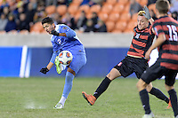 Houston, TX -  Friday, December 9, 2016: Mauricio Pinede (2) of the North Carolina Tar Heels takes a shot at the Stanford Cardinal goal in the second half  at the  NCAA Men's Soccer Semifinals at BBVA Compass Stadium.