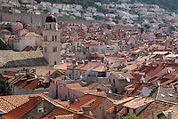 View across the rooftops of the Old Town, with the 14th century Franciscan monastery on Stradun or Placa on the left, Dubrovnik, Croatia. The city developed as an important port in the 15th and 16th centuries and has had a multicultural history, allied to the Romans, Ostrogoths, Byzantines, Ancona, Hungary and the Ottomans. In 1979 the city was listed as a UNESCO World Heritage Site. Picture by Manuel Cohen