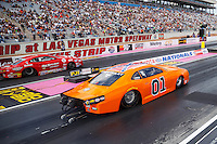Oct 28, 2016; Las Vegas, NV, USA; NHRA pro stock driver Bo Butner (right) with his Dukes of Hazzard themed car with Confederate Flag on the roof races alongside Drew Skillman during qualifying for the Toyota Nationals at The Strip at Las Vegas Motor Speedway. Mandatory Credit: Mark J. Rebilas-USA TODAY Sports