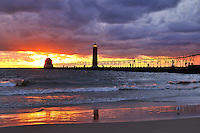 The setting sun lights up the sky at Grand Haven