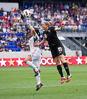Rachel Buehler (19) of the USWNT  goes up for a header with Monica Ocampo (24) of Mexico during the game at Red Bull Arena in Harrison, NJ.  The USWNT defeated Mexico, 1-0.