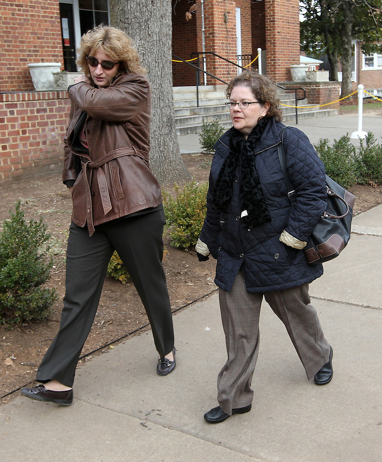CHARLOTTESVILLE, VA - FEBRUARY 14: Medical College of Virginia-based brain doctor Christine Fuller, left, and Dr. Maria-Beatriz Lopes, right, a neuropathology fellow at UVA, testified about brain injuries to Yeardley Love during the George Huguely trial. Huguely was charged in the May 2010 death of his girlfriend Yeardley Love. She was a member of the Virginia women's lacrosse team. Huguely pleaded not guilty to first-degree murder. (Credit Image: © Andrew Shurtleff