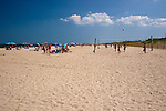 Away from the center of town at Rehoboth Beach, Delaware, visitors have more room to enjoy sand, sun, and surf or to play at the beach volleyball nets.  Rehoboth Beach, Delaware, USA.