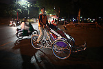 A cyclo driver looks for a fare in Hue, Vietnam. Dec. 27, 2012.