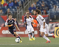 Real Salt Lake midfielder Kyle Beckerman (5) dribbles at midfield.  In a Major League Soccer (MLS) match, Real Salt Lake (white)defeated the New England Revolution (blue), 2-1, at Gillette Stadium on May 8, 2013.