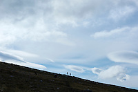 Silhouette of distant hikers against sky between Teusjaure and Vakkotavare, Kungsleden trail, Lapland, Sweden