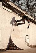 March 6, 2012. Carrboro, NC.. Randy Browne, wallride.. Skateboarding at Lumpside, a DIY concrete skate spot.