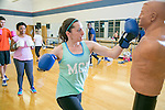 Duke undergrads and graduate students enjoy Fit Box, an upbeat class offered by Duke Recreation and Physical Education that teaches proper form on punches and puts them together in fun combos for a great workout, at Wilson Recreation Center. Personal fitness instructor Mario Sanders leads the class.