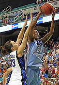 Jessica Breland (51) tries to make a shot past Duke's Haley Peters in the first half. This was the Championship game of the 2011 ACC Tournament in Greensboro on March 6, 2011. Duke beat UNC 81-66. (Photo by Al Drago)