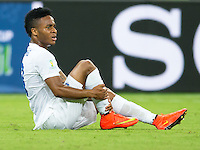 Raheem Sterling of England hold his shin