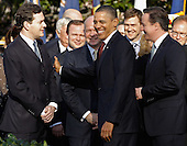 U.S. President Barack Obama (C) and British Prime Minister David Cameron (R) greet British Chancellor of the Exchequer George Osborne (L) and British Foreign Secretary William Hague during an official arrival ceremony on the South Lawn of the White House March 14, 2012 in Washington, DC. Prime Minister Cameron is on a three-day visit to the U.S. and he is expected to have talks with Obama on the situations in Afghanistan, Syria and Iran. .Credit: Chip Somodevilla / Pool via CNP