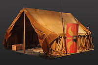 Model of a Roman tent, called a papilio (butterfly) because it had 2 flat slides ressembling  wings, used by the Roman army while on campaign, at the Tullie House Museum and Art Gallery, Carlisle, Cumbria, England. Tents found in Carlisle were made of goatskin and occupied by 8 soldiers, 2 of whom were always on guard duty. Centurions and other officers had larger, more elaborate tents. Carlisle sits at the Western end of Hadrian's Wall. Hadrian's Wall was built 73 miles across Britannia, now England, 122-128 AD, under the reign of Emperor Hadrian, ruled 117-138, to mark the Northern extent of the Roman Empire and guard against barbarian attacks from the Picts to the North. The wall was fortified with milecastles with 2 turrets in between, and a fort about every 5 Roman miles. Picture by Manuel Cohen