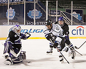 Matt Ginn (HC - 35), Brett Switzer (Bentley - 25), Nathaniel Domagala (HC - 7) - The Bentley University Falcons defeated the College of the Holy Cross Crusaders 3-2 on Saturday, December 28, 2013, at Fenway Park in Boston, Massachusetts.
