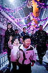 SHENZHEN, CHINA JANUARY 1: Chinese tourists experience snow and ice at Windows of the world theme park on January 1, 2009 in central Shenzhen, China. The park has various attractions such as roller coasters, water rides and Walt Disney style live shows for children. Chinese people love theme parks and new ones are opening constantly. It's estimated that there's about 2400 theme parks in the country. Many of the most popular parks are located around Shenzhen and over the border in Hong Kong. (Photo by Per-Anders Pettersson/Getty Images)