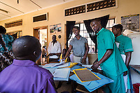 "Gulu, Uganda, Africa. ""David,"" 16, is brought to the local mental hospital by his mother & father for an initial psychiatric evaluation for his violent outbursts. With so few resources to address mental health in developing countries the care usually falls to the family members and the process can often be overwhelming."