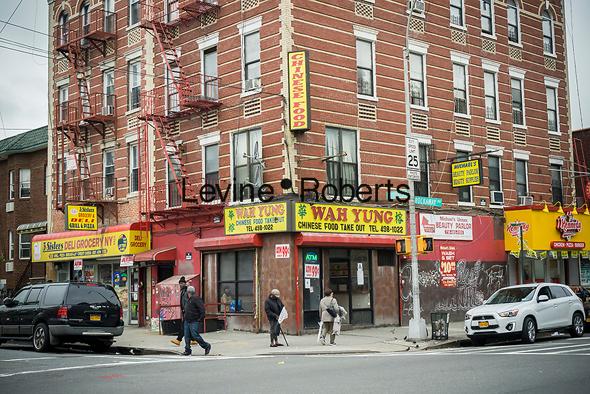 Street corner with Chinese food take-out restaurant in the Brownsville neighborhood of Brooklyn in New York on Saturday, May 7, 2016.  (© Richard B. Levine)